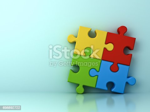 688372024istockphoto Four colorful jigsaw puzzle pieces concept on cyan wall background with shadow and reflection . 3D render 698892722