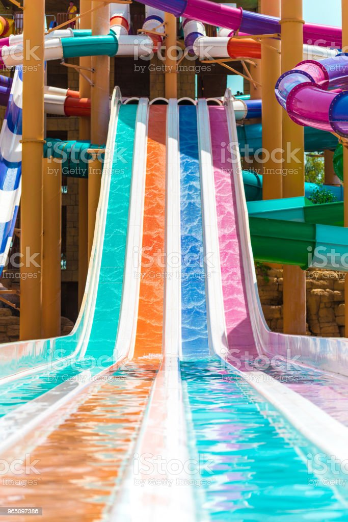 Four colorful slide in hotel aqua park royalty-free stock photo