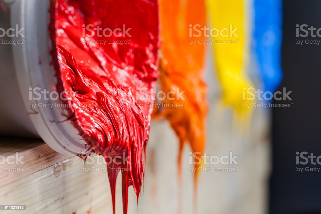 four colors of ink for print tee shirt flowed out of barrel stock photo