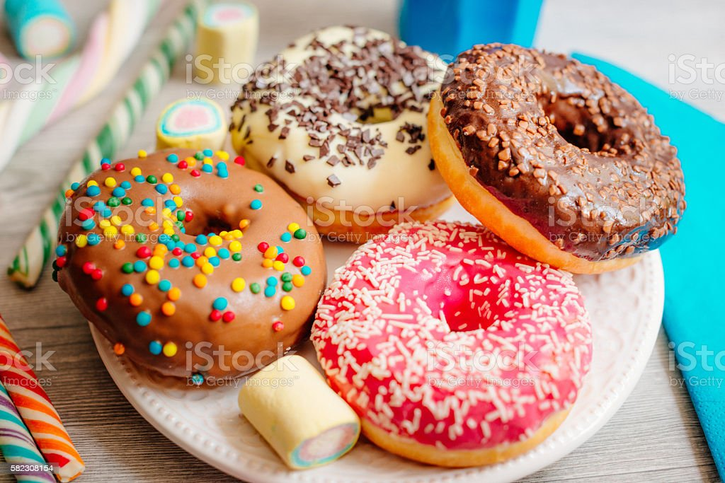 Four colours of donuts royalty-free stock photo