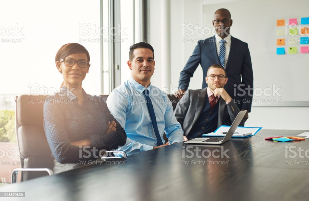 Four confident successful business partners stock photo