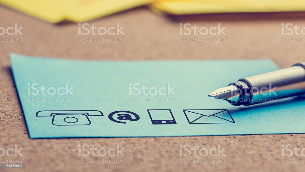 Four Contact Icons Printed on a Light Blue Paper stock photo