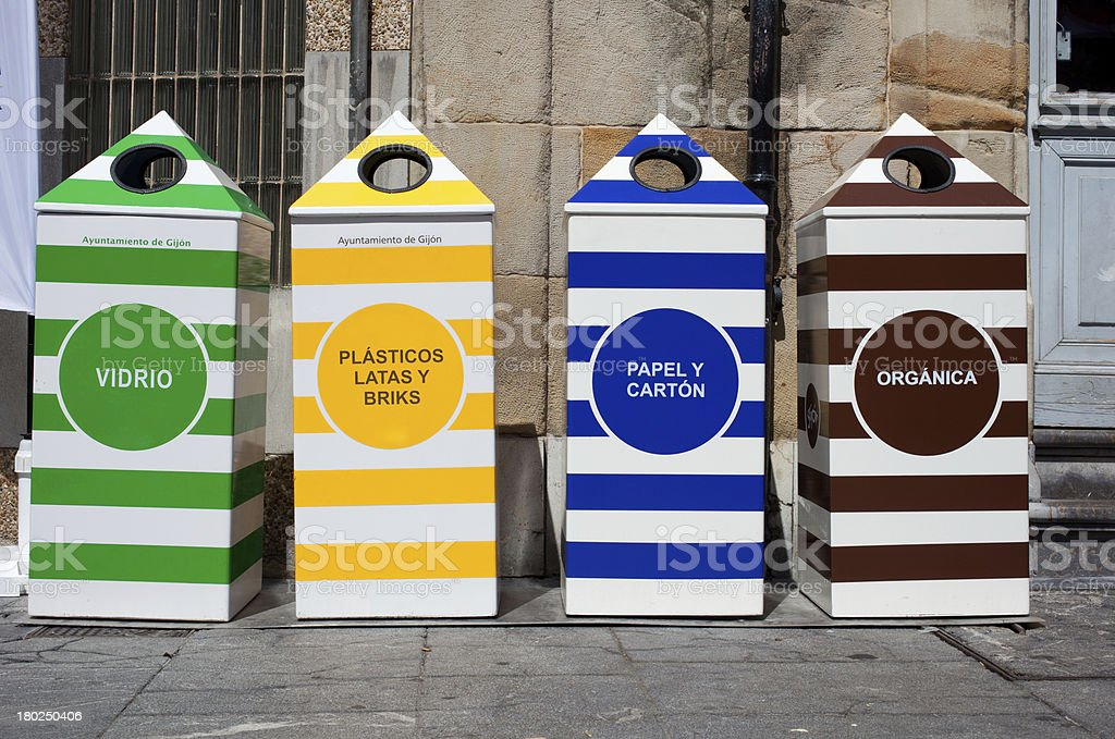 Four containers for recycling paper, metal, plastic and glass royalty-free stock photo