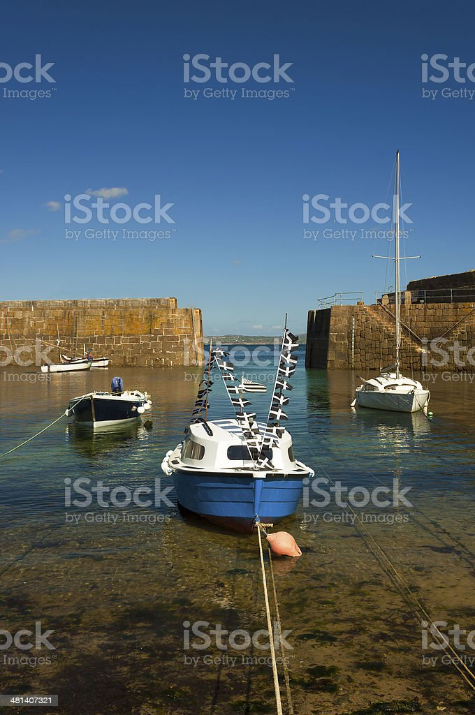 Four contrasting sea vessels in Mousehole Harbour stock photo