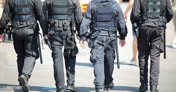 four cops patroling the city with bulletprof vest