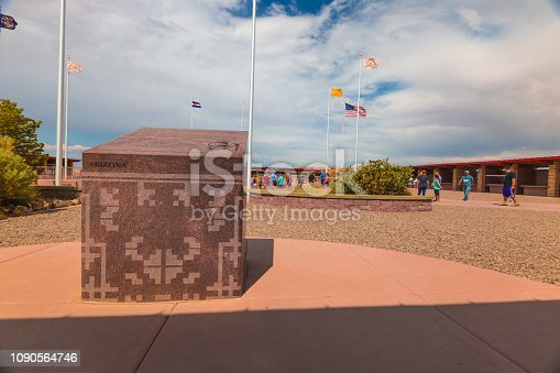 Four Corners Monument, Border of the State of Utah, Colorado, New Mexico, and Arizona, USA - July 26 2018: The Intersection of four states in the southwest of USA. The Four Corners Monument Marking the exact location of the intersection.