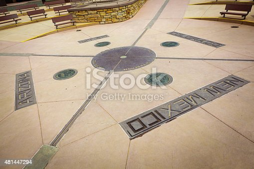 The Four Corners Monument at the border of Utah, Colorado, New Mexico, and Arizona. A popular tourist site in the southwestern USA. A bronze plate marking the location.Photographed on location in horizontal format.