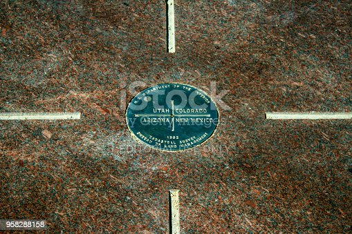 The Four corners Monument placard in the American Southwest