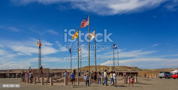 Tourists wander around the Four corners Monument in the American Southwest
