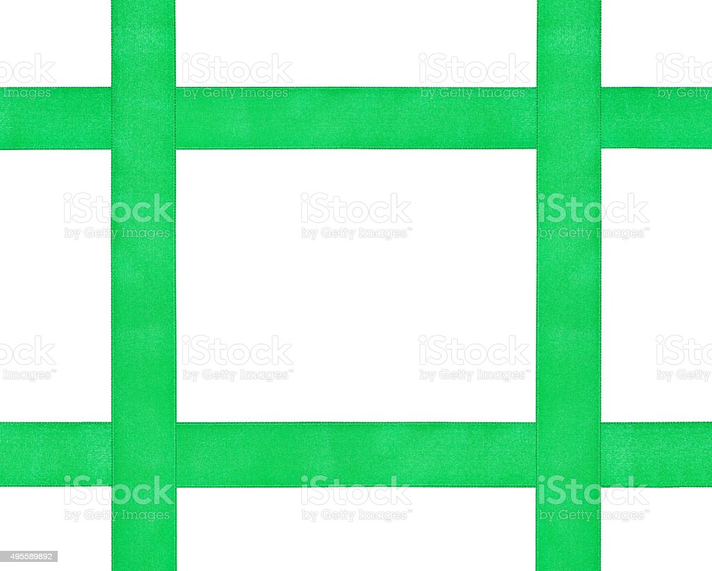 four crossing green satin ribbons isolated stock photo
