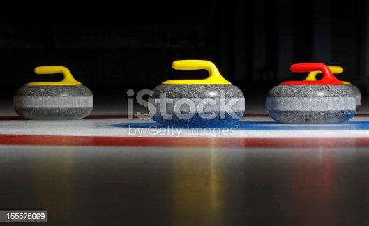 istock four curling stones 155575669