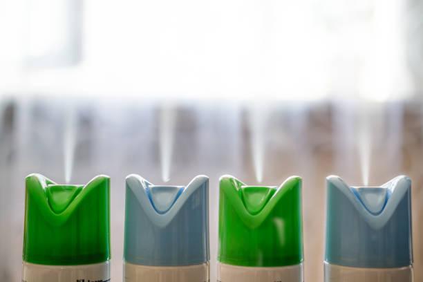 four cylinder of air freshener in a row. - spruzzo profumo foto e immagini stock