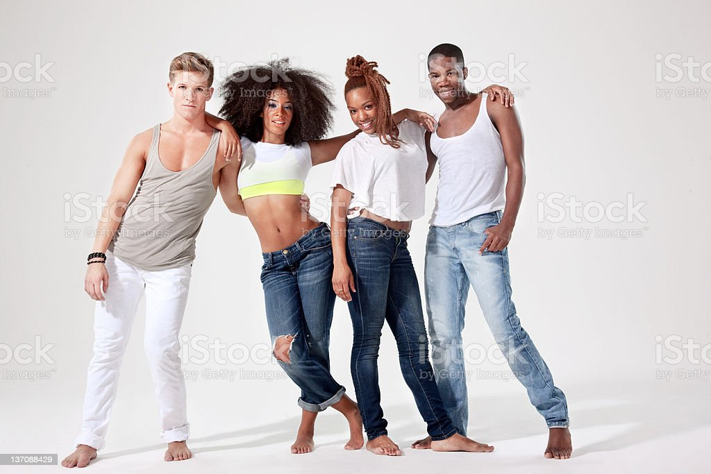 Four dancers relaxing side by side stock photo