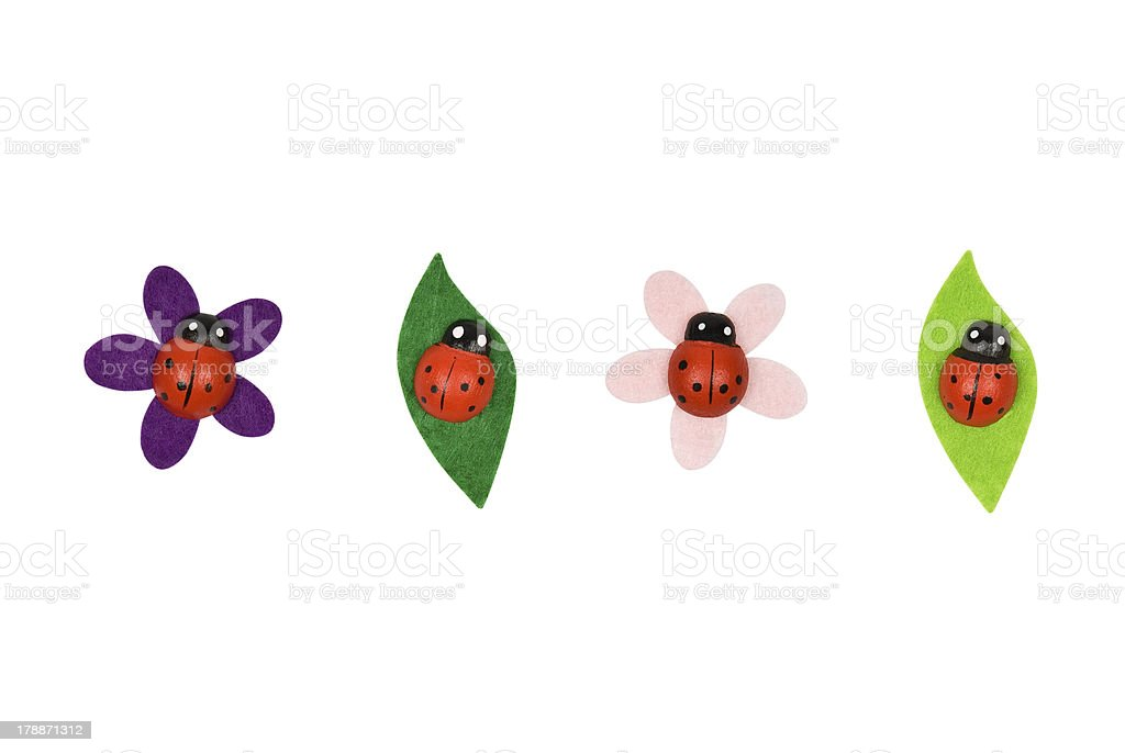 Four decorative toy ladybirds. Clipping path included. royalty-free stock photo