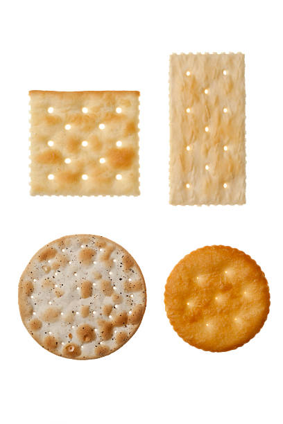 four different crackers in white background - 克力架 個照片及圖片檔
