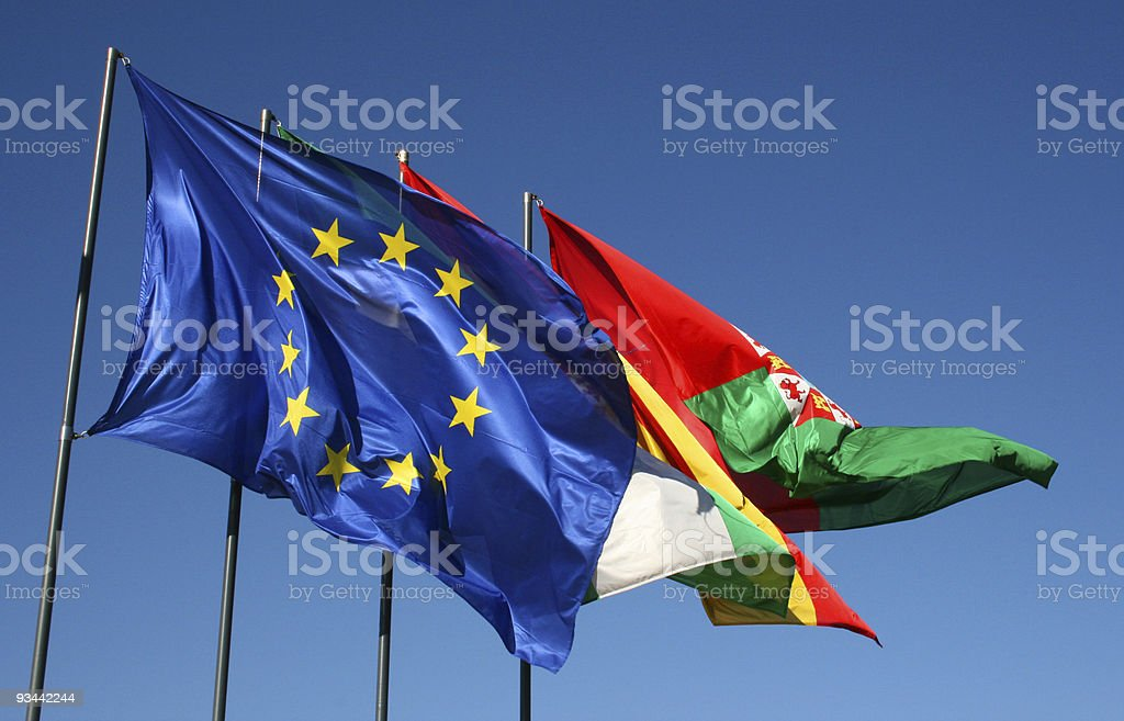 Four different european flags with wind and blue sky royalty-free stock photo