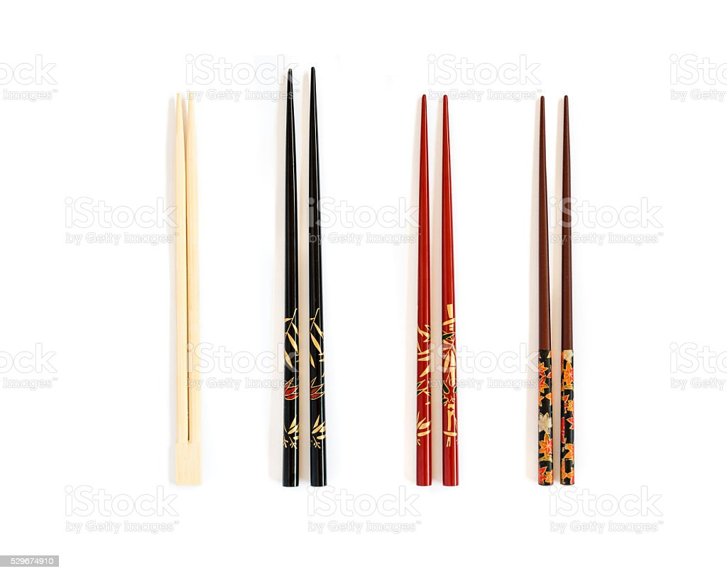 Four different pairs of chopsticks stock photo