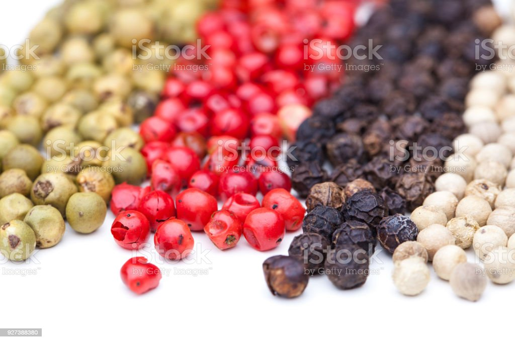 Four different typed of pepper in a row stock photo
