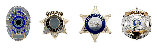 Four different types of law enforcement badges stock photo