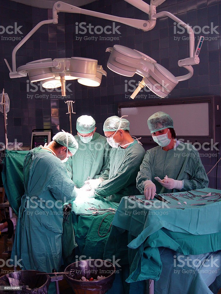 Four doctors performing an operation royalty-free stock photo