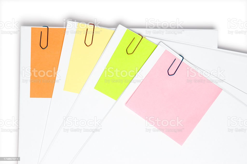 Four documents marked with diferent colored notes royalty-free stock photo