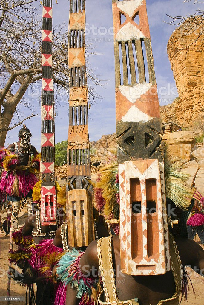 Four Dogon Dancers, Masks and Stilts stock photo