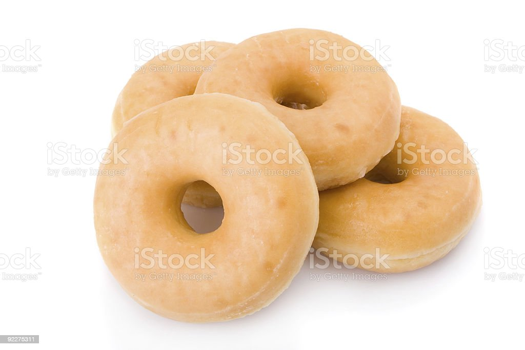 Four doughnuts or donuts isolated on white stock photo