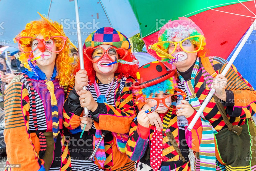 Four dressed as clowns at the Carnaval in Prado, Portugal stock photo