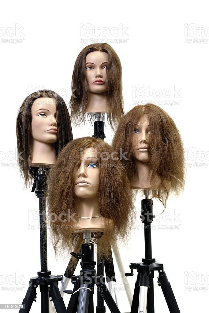 four dummy heads with wigs stock photo