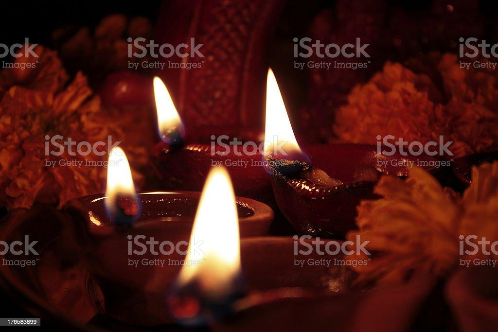 four earthen lamps(diya) on diwali stock photo