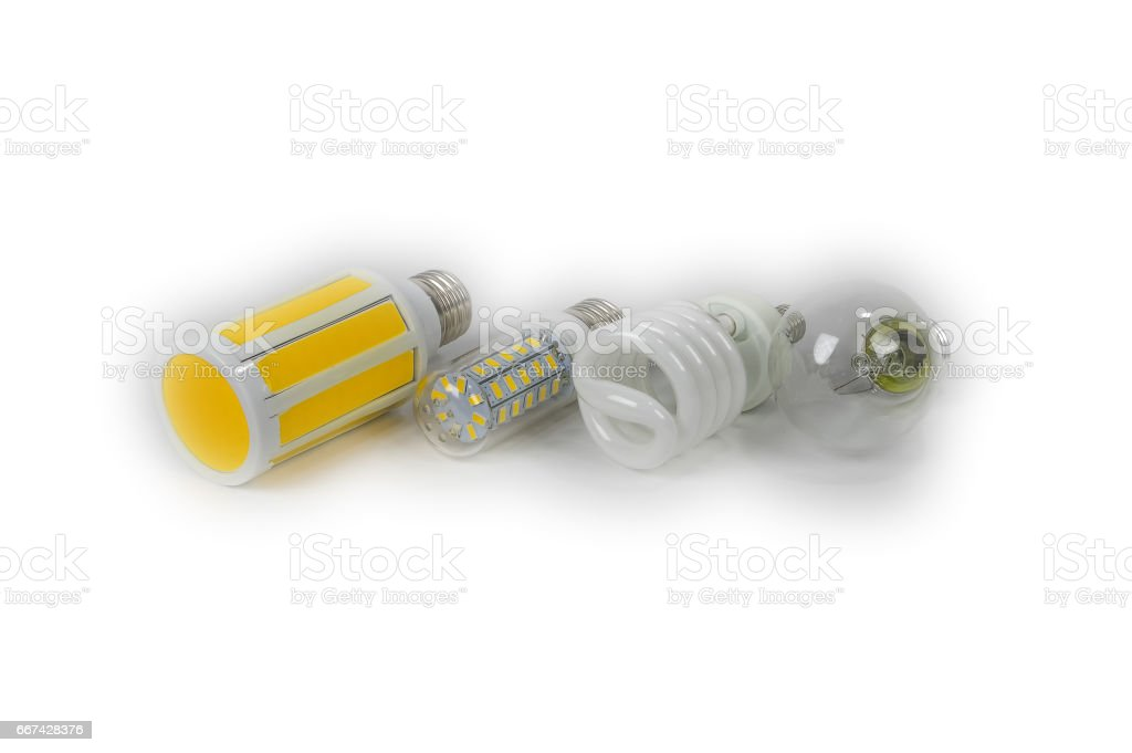 Four electric lamps isolated, a glow lamp, fluorescent, LED. stock photo
