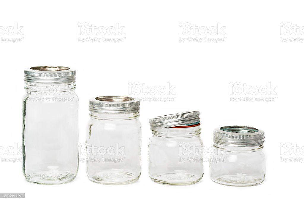 Four empty glass jar stock photo