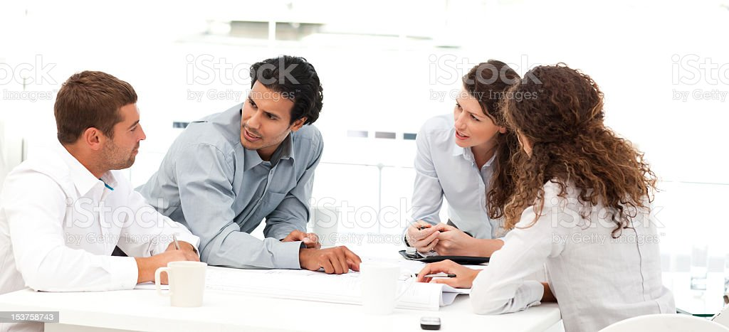 Four engineers discussing about a new project royalty-free stock photo