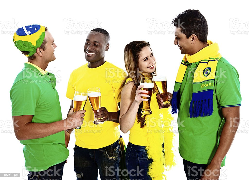 Four enthusiastic Brazilian soccer fans meet over beer royalty-free stock photo