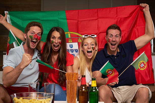 four enthusiastic portuguese soccer fans - football portugal flag bildbanksfoton och bilder