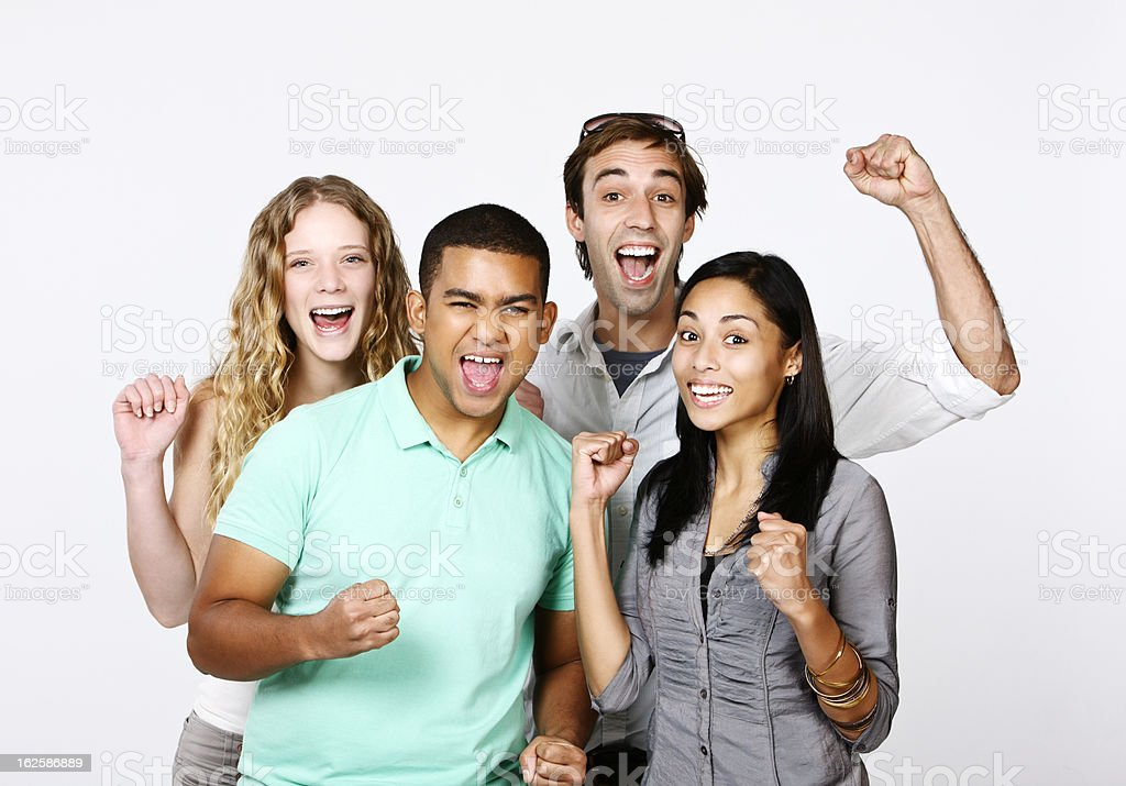 Four Excited Friends Cheering Something Or Someone On Stock Photo