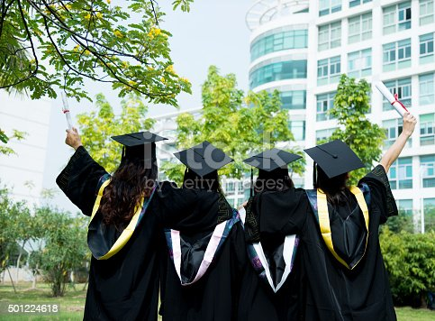 858462408istockphoto Four female graduates at campus 501224618