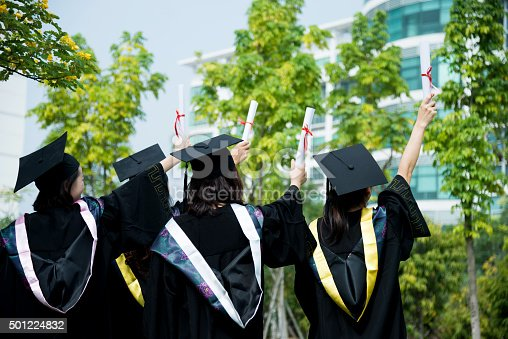 858462408istockphoto Four female graduates at campus 501224832