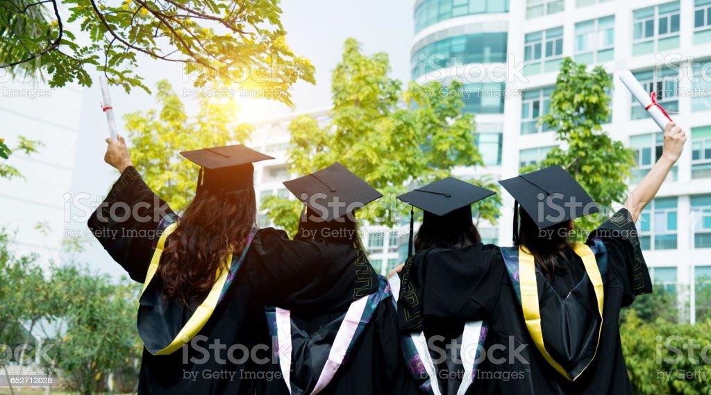 Four female graduates at campus stock photo