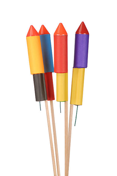 Four firework rockets in different colors stock photo