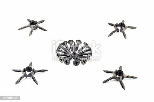 istock Four five-pointed stars and a circular composition are lined with black screws 696584652