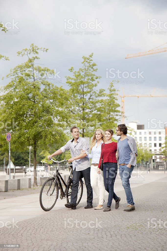 Four friends going for a walk in Berlin royalty-free stock photo