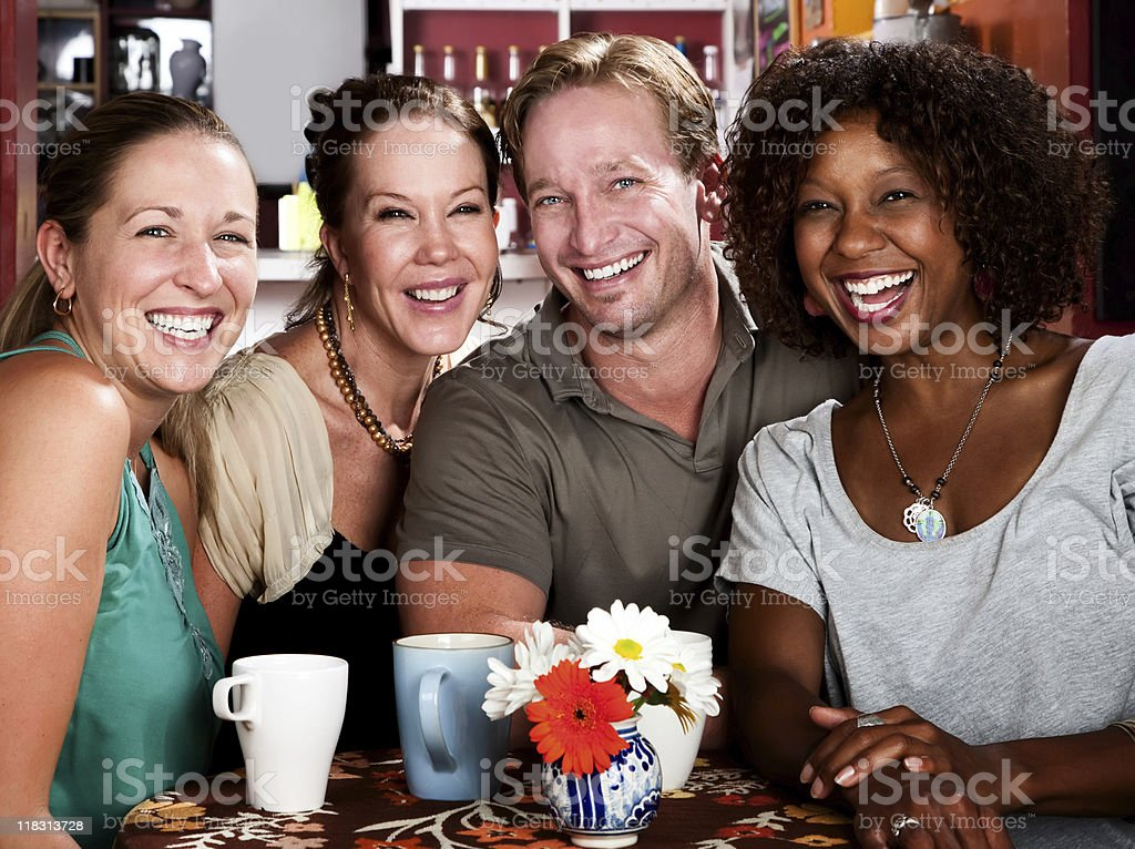 Four Friends Gossiping in a Coffee House royalty-free stock photo
