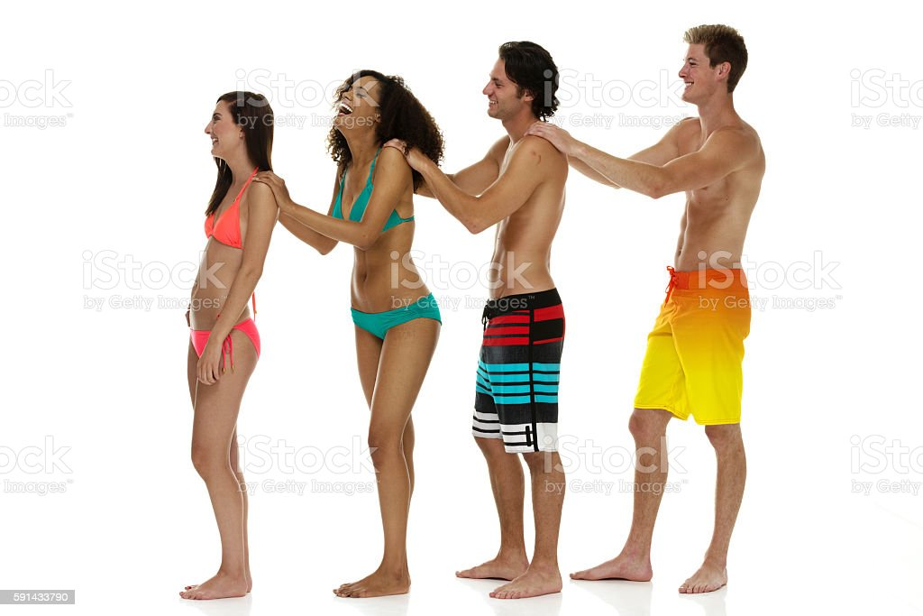 Four friends in swimming clothes stock photo