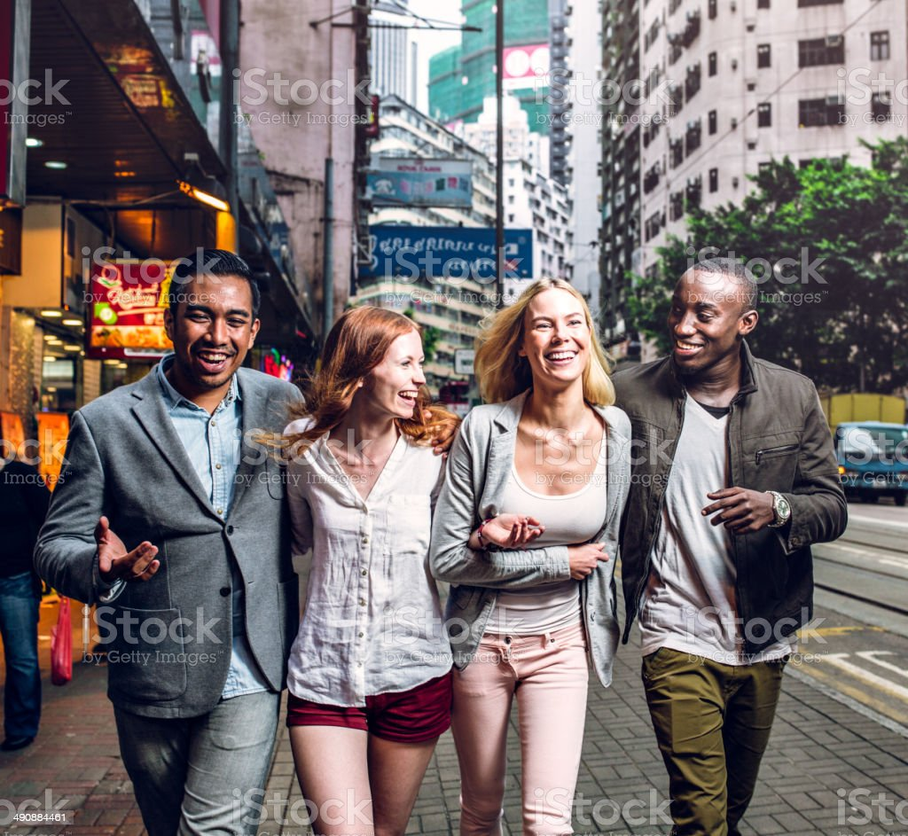 Four friends in the city stock photo