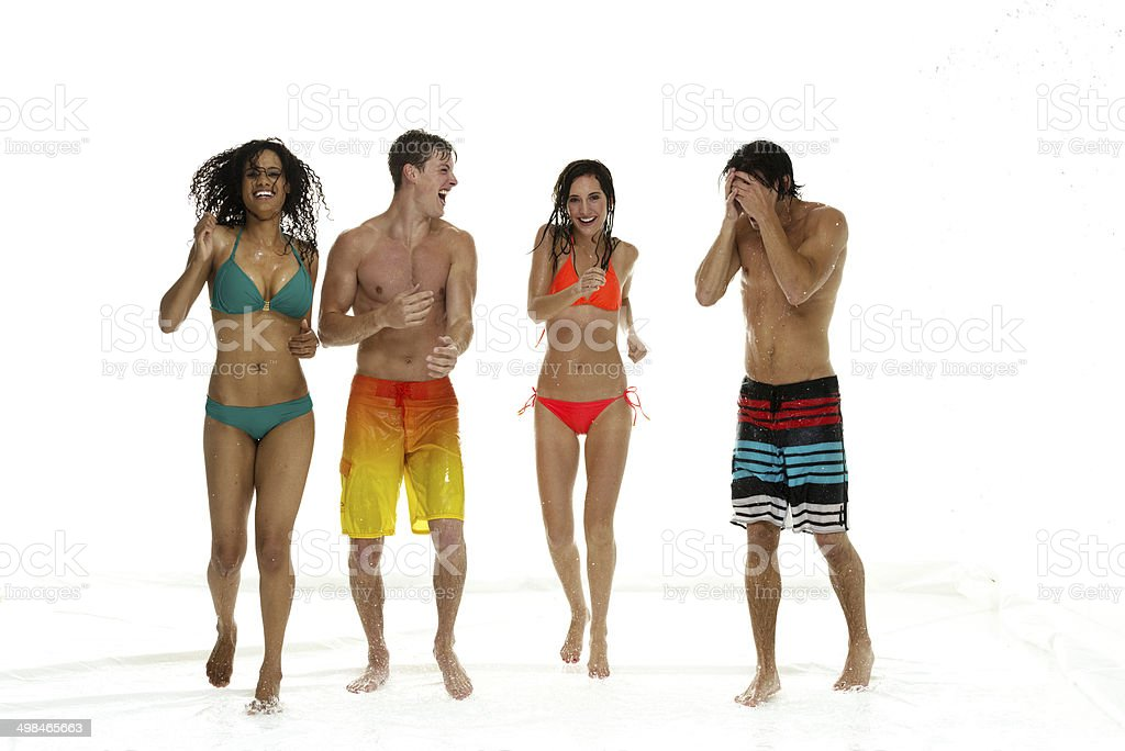 Four friends standing around having fun stock photo
