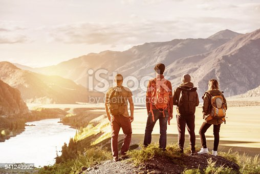 istock Four friends sunset mountains travel concept 941249992