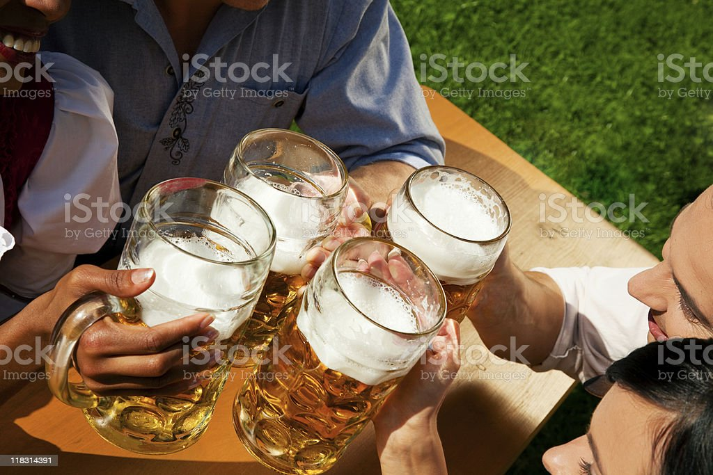 Four friends toasting with beer royalty-free stock photo
