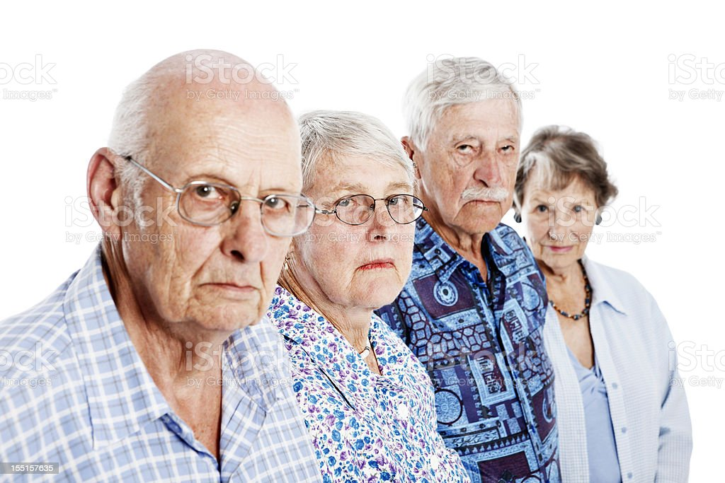 Four frowning seniors show disapproval and disappointment stock photo