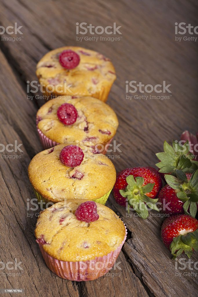 Four Fruit muffins in a row royalty-free stock photo